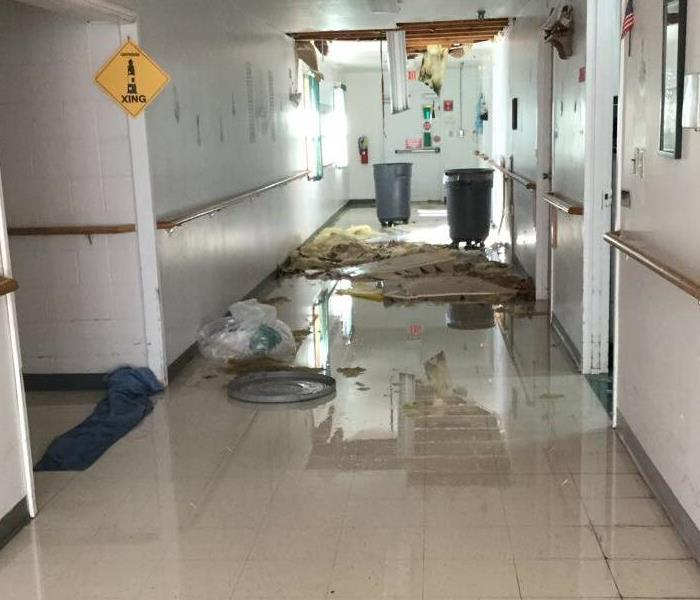 Water in Nursing home hallway from pipe.