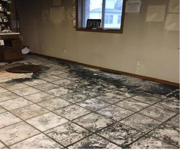 Fire hit the Barber Shop, dirty soot stained tile