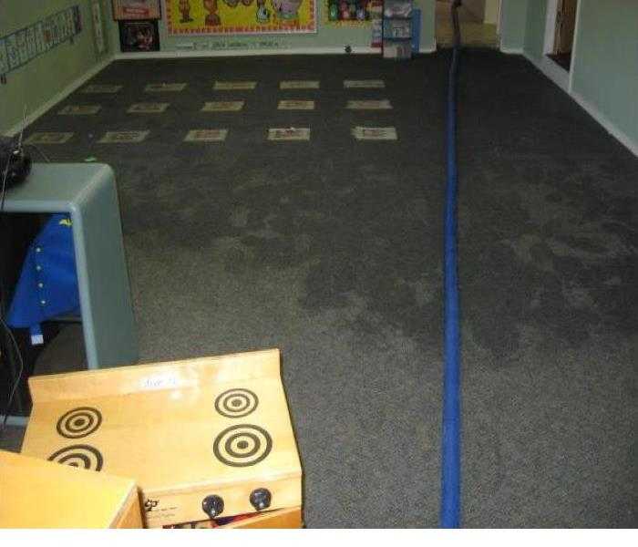 Wet carpet in daycare room